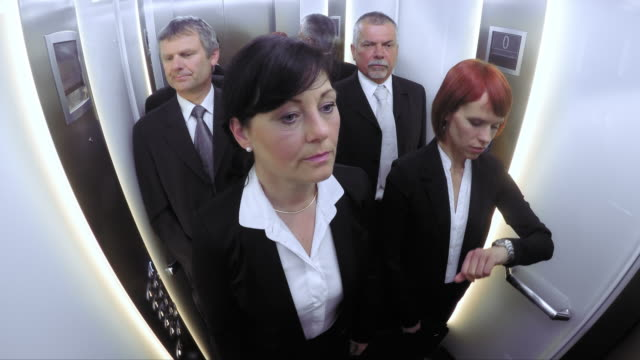 POV Business people in the elevator