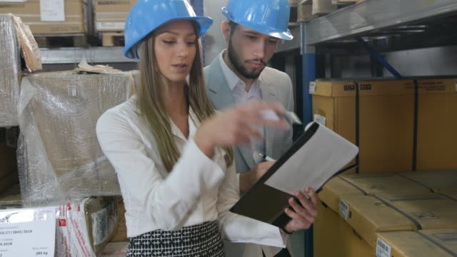 business people in warehouse - ecuadorian ethnicity stock videos and b-roll footage