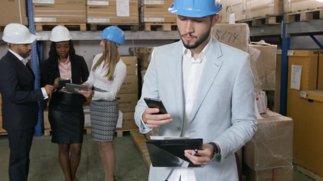 business people in warehouse - ecuadorian ethnicity stock videos & royalty-free footage