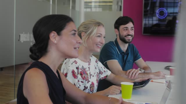 Business people laughing in business meeting