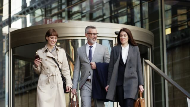 business people leaving office after work - colleague stock videos & royalty-free footage