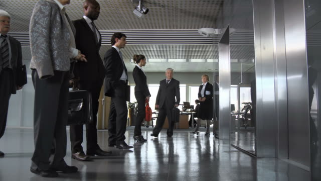 hd dolly: business people leaving work - lobby stock videos & royalty-free footage