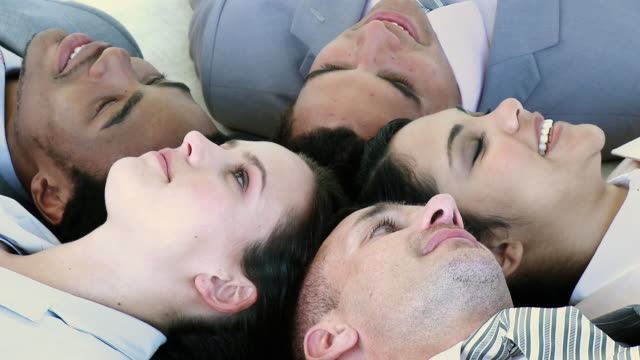 cu business people lying in circle touching heads / cape town, south africa - see other clips from this shoot 1790 stock videos & royalty-free footage