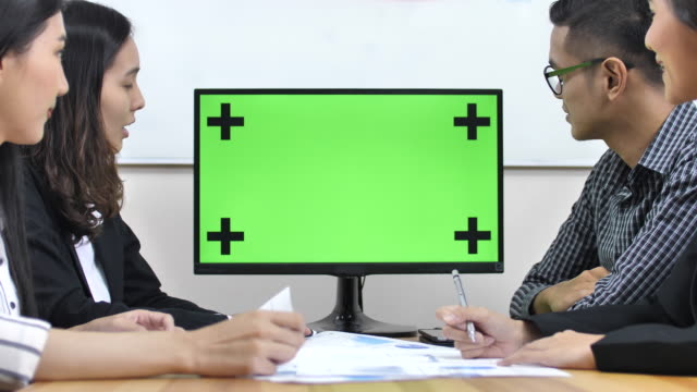business people meet in front of chroma key monitor - leadership stock videos and b-roll footage