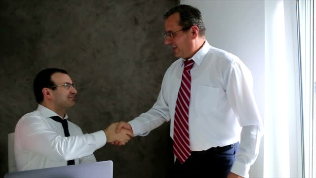 Business people meeting and shaking hands in office