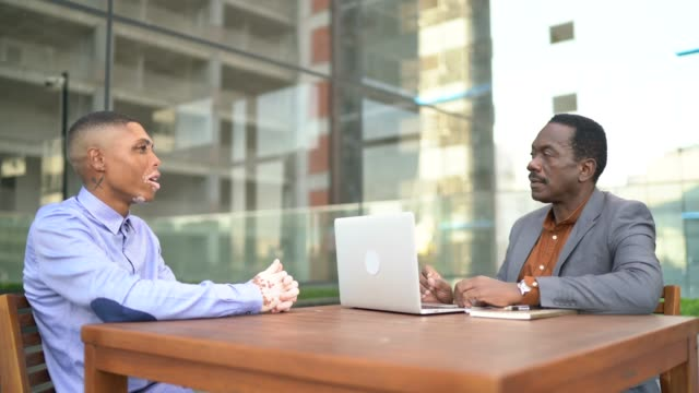 business people on a job interview or meeting coach at building rooftop - colleague stock videos & royalty-free footage
