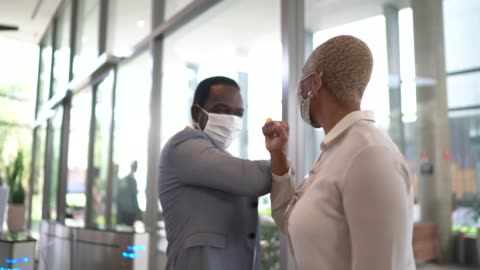 business people on a safety greeting for covid-19 on office's lobby - with face mask - voice stock videos & royalty-free footage