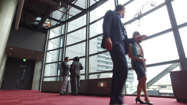 Business people on the move at a conference