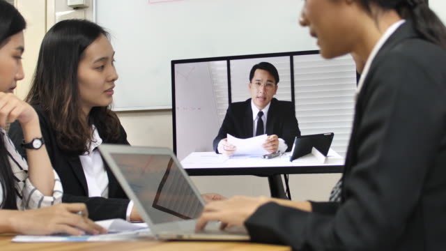 Business people on video call with investor