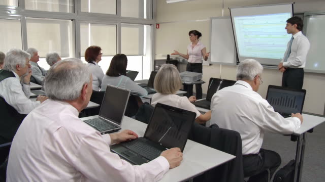 hd: business people participating seminar - mature student stock videos & royalty-free footage