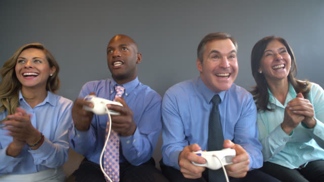 Business people playing video games at the office