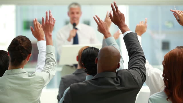 business people raising their hands together - arms raised stock videos & royalty-free footage