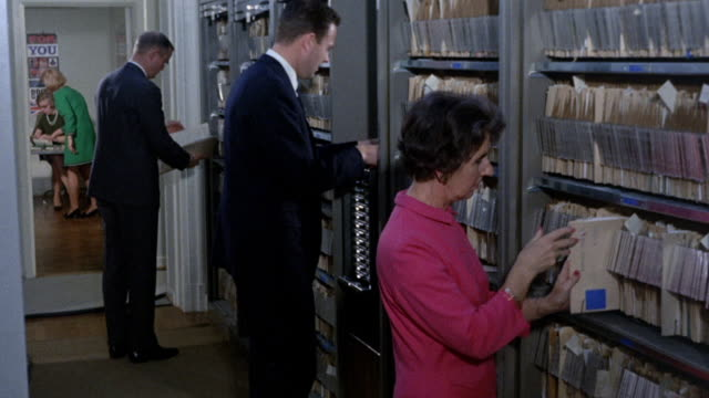 1968 montage business people researching export records / united kingdom - file clerk stock videos & royalty-free footage