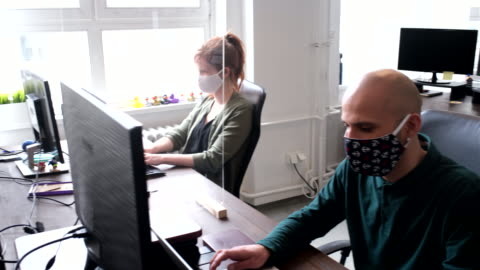 business people return back to work after pandemic lockdown - white collar worker stock videos & royalty-free footage