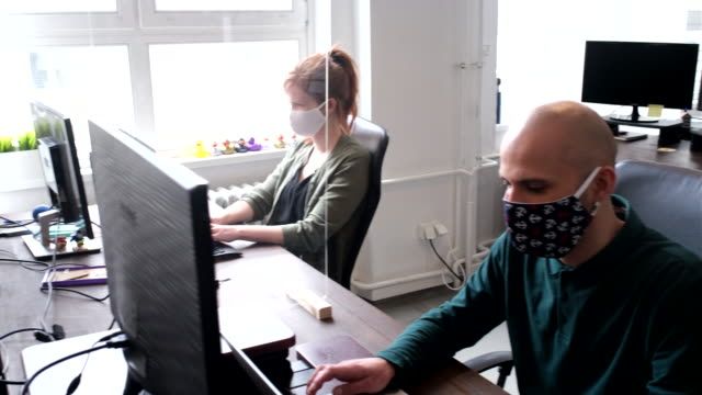 business people return back to work after pandemic lockdown - health and safety stock videos & royalty-free footage