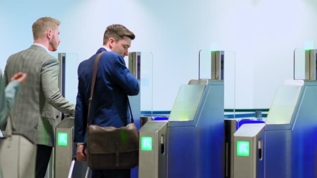 Business people scanning tickets