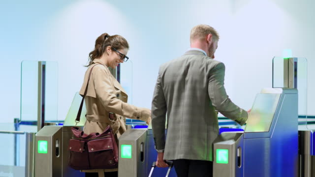 business people scanning tickets - ticket stock videos and b-roll footage