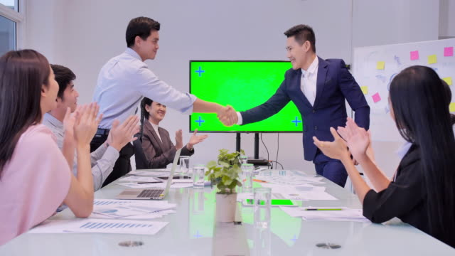 business people shaking hands, finishing up a meeting.entrepreneurs and business people conference on green screen in modern meeting room.business people teamwork meeting corporate.business celebrations,business,people,technology,success,winning concept. - support stock videos & royalty-free footage