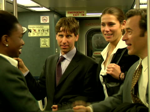 CU, Business people shaking hands in subway train, Chappaqua, New York State, USA
