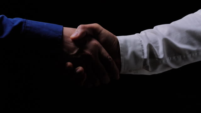 business people shaking hands,finishing up a meeting on black background.celebration,success,teamwork,collaboration,support,togetherness,business etiquette,congratulation,merger,acquisition concepts.handshakes: non-caucasian - chance stock videos & royalty-free footage