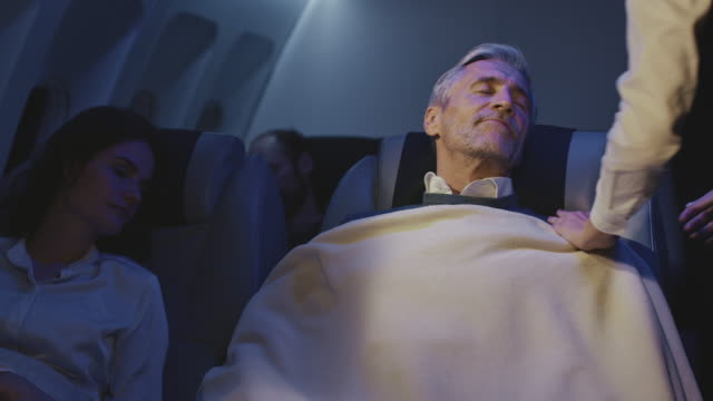 business people sleeping in private airplane - crew stock videos & royalty-free footage
