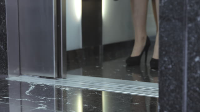 slo mo ds business people stepping out of the elevator - formal businesswear stock videos & royalty-free footage