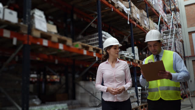 business people supervising the operation of a distribution warehouse - world trade organisation stock videos & royalty-free footage