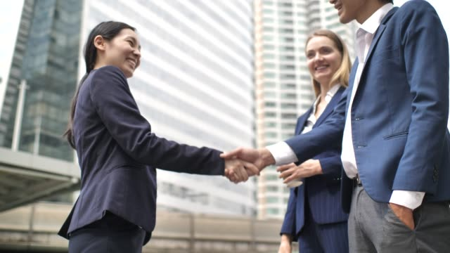 business people talking and handshaking - asian chance stock videos & royalty-free footage