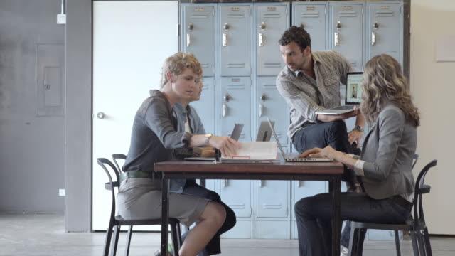 business people talking in meeting - vanguardians stock videos & royalty-free footage