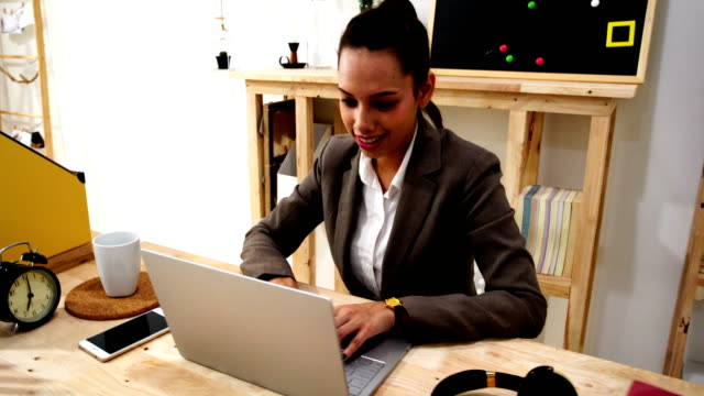 business people using laptop and reviewing blueprints at desk - one mature woman only stock videos & royalty-free footage
