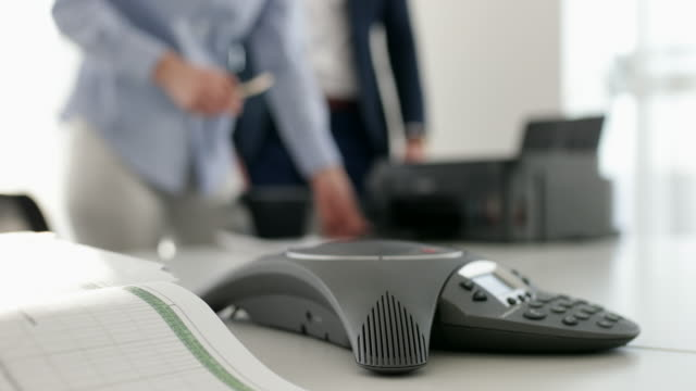 business people using printer in office - conference phone stock videos & royalty-free footage