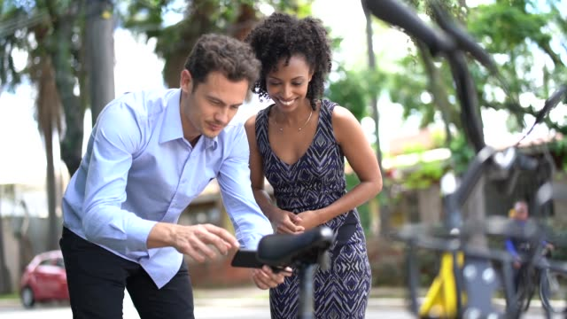 business people using smartphone scanning the qr code of shared bike in city - unlocking stock videos & royalty-free footage