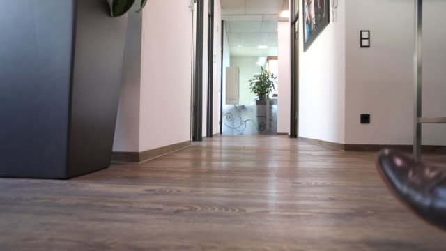 business people walking in a corridor - oberteil stock-videos und b-roll-filmmaterial