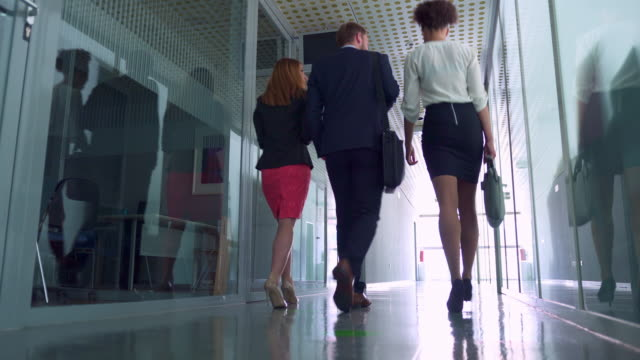 business people walking in corridor - after work stock videos & royalty-free footage