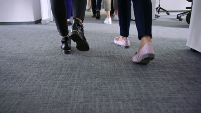 business people walking in office corridor - flooring stock videos & royalty-free footage