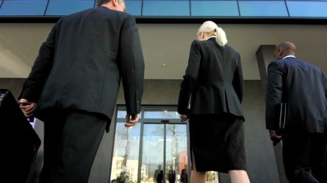td business people walking into the building - three people stock videos & royalty-free footage