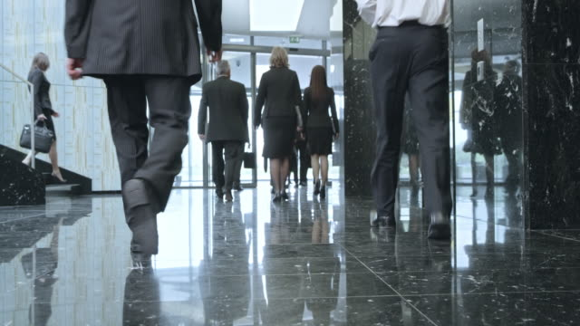 ld business people walking through a lobby and out of the building - busy stock videos & royalty-free footage