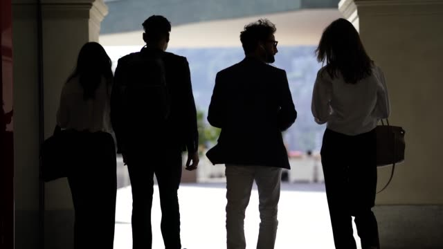 business people walking together in a group - business casual stock videos & royalty-free footage