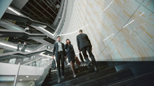ds business people walking up and down staircase - steps and staircases stock videos & royalty-free footage