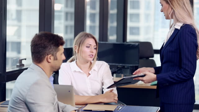 business people with a team in office meeting - assistant stock videos & royalty-free footage