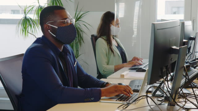 business people with face masks working in office - event stock videos & royalty-free footage