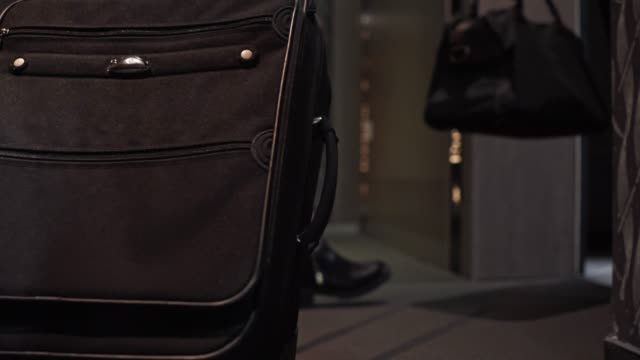 business people with luggage entering the hotel room - lobby video stock e b–roll