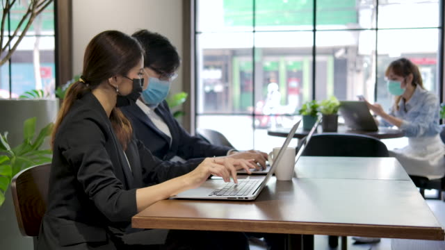 business people working at desk in office. - social gathering video stock e b–roll