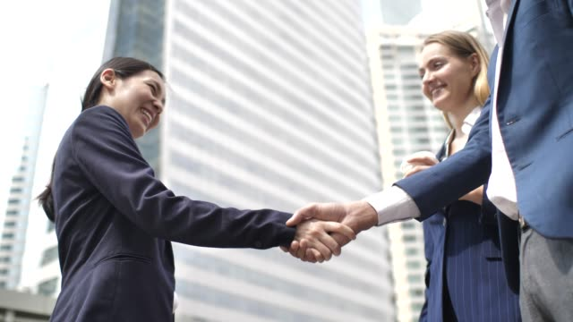 business person greet each other and shake hands in modern office building - trust stock videos & royalty-free footage
