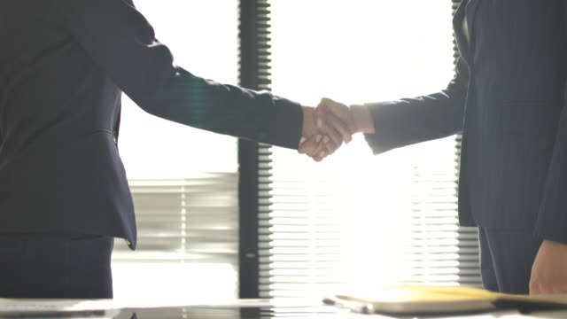 business person handshake - handshake stock videos & royalty-free footage