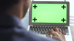 Business person Looking on Laptop green screen