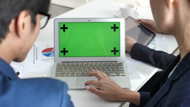 business person team using laptop green screen - microsoft stock videos and b-roll footage
