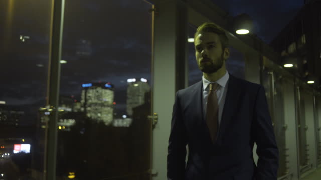 Business person walking in city at evening