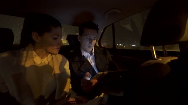 business persons on their way to a meeting. - crowdsourced taxi stock videos and b-roll footage