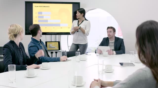 business presentation in boardroom - strategia di vendita video stock e b–roll